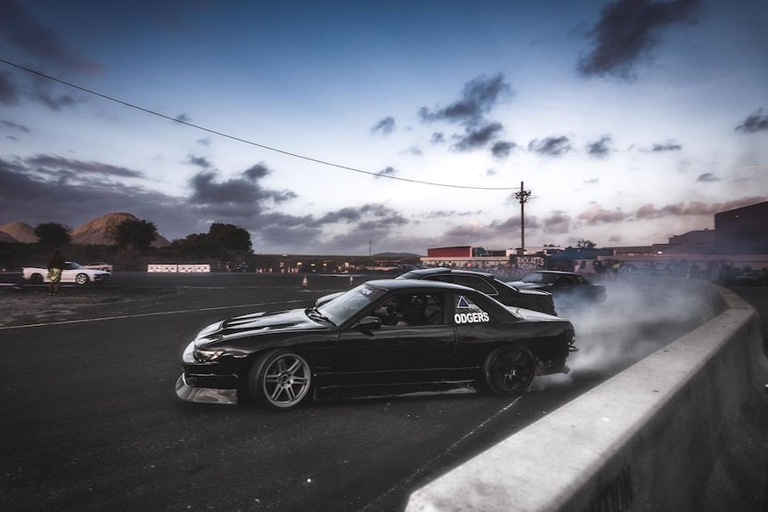 Three cars at a drifting event at Archerfield Drift Park on Brisbane's southside.