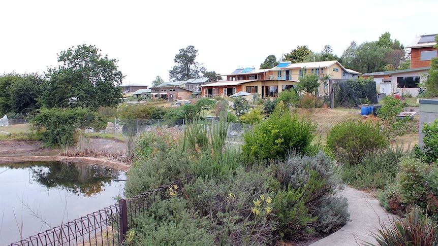 Bend eco-neighbourhood houses overlooking permaculture gardens