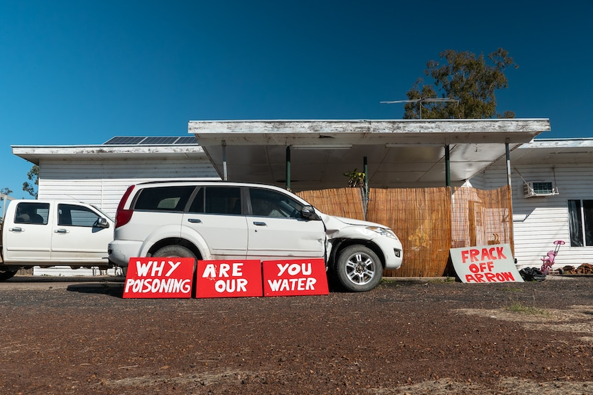 Red anti-CSG signage displayed outside a house