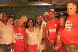 Kevin Michel and volunteers celebrate his win.