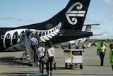 Passengers board an Air New Zealand flight at Christchurch Airport