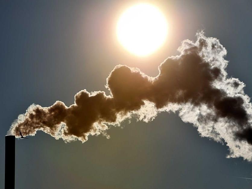 Smoke rises from chimney