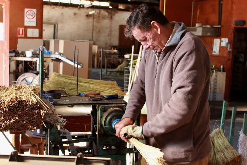 Broom maker making brooms in the Tumut factory.