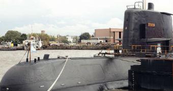 San Juan submarine docked in a harbour.