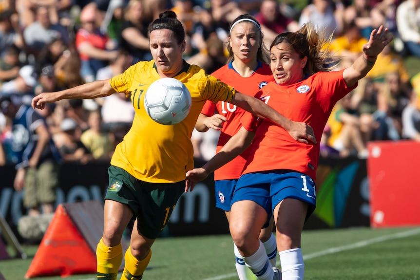 Lisa De Vanna and Geraldine Leyton contest the ball in the Australia versus Chile friendly.