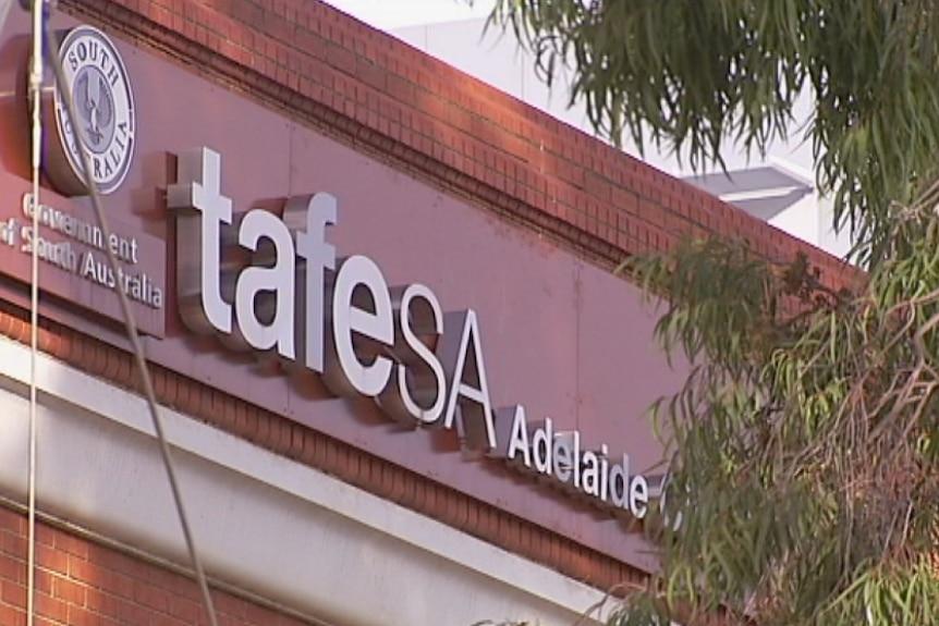 TAFE SA signage on a brick wall.