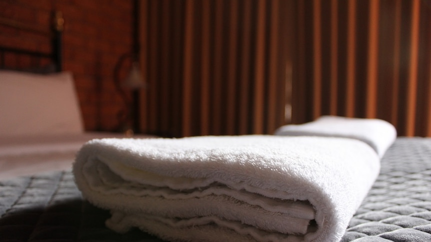 Towels on the bed of a hotel room in regional Victoria