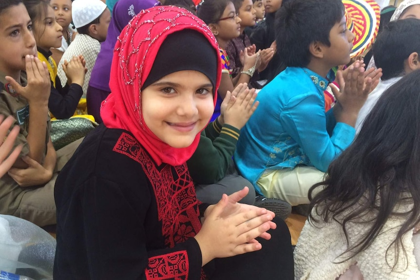 Islamic student smiles at camera at Islamic College of Melbourne