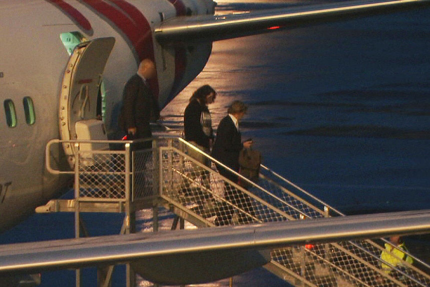 One of the accused arrives at Adelaide Airport