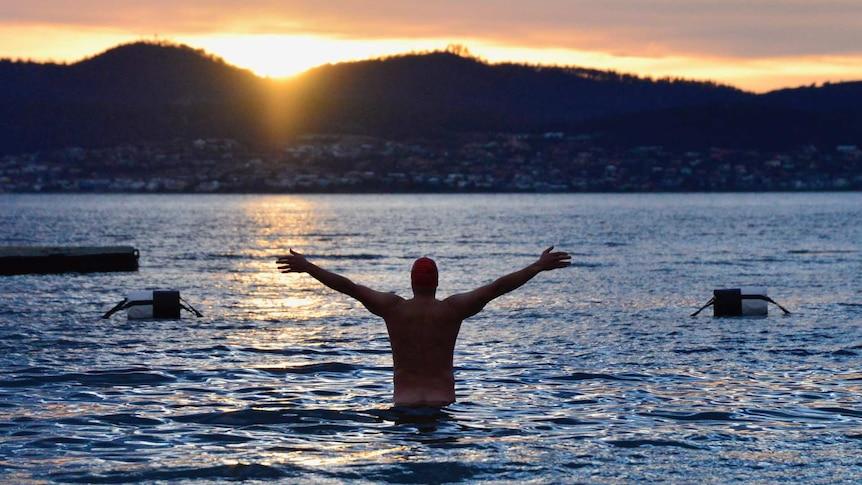 Last man in at the 2018 Dark Mofo nude swim, Hobart - ABC