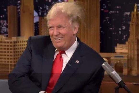 Donald Trump looks away with his hair standing on end