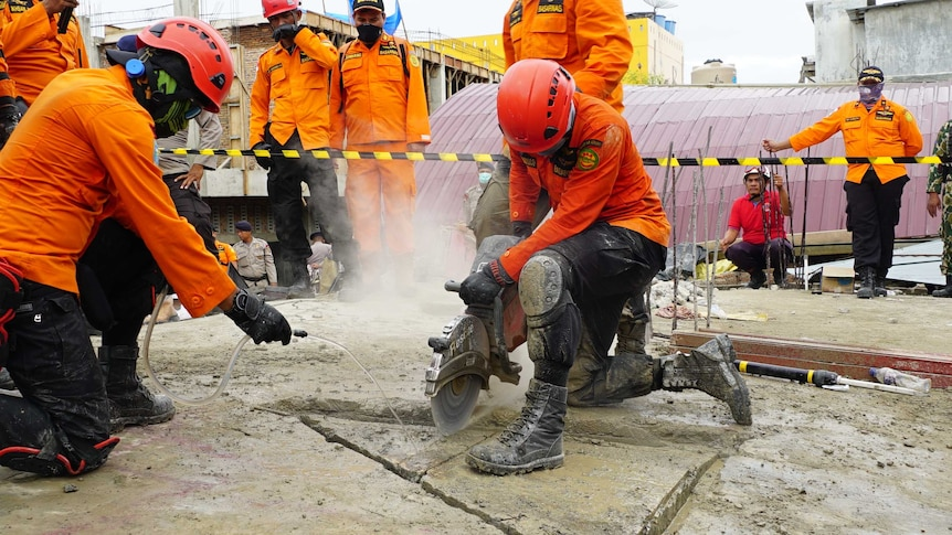 Rescue crews drill into the ground as they look for survivors of the Indonesia earthquake.