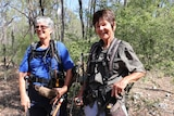 Two gold prospectors stand in a state forest near Clermont in central Queensland