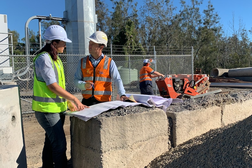 A man and a woman at a construction site.