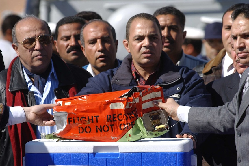 Egyptian authorities take the black box of the Flash Airlines flight that crashed off the Egyptian coast.