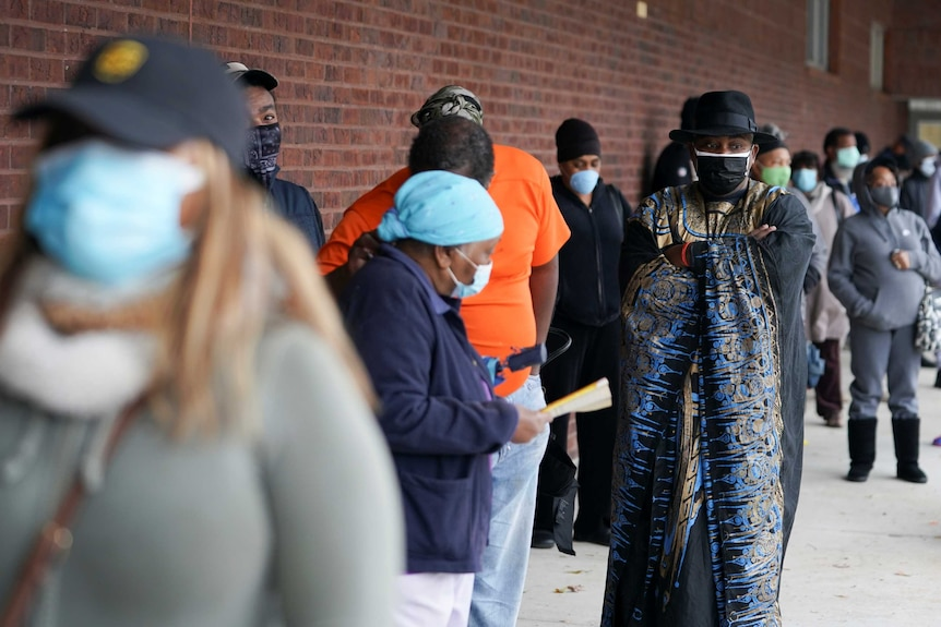 Early voters queue to cast their votes