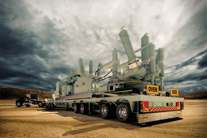 An Ampcontrol electrical transformer sits on the back of a truck with dramatic clouds in the background.
