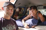 Jennifer Williams and Michael Boyd stand at the rear door of their converted campervan.
