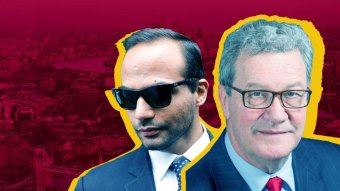 A man in a suit and dark sunglasses and Alexander Downer.