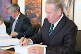 Premier Colin Barnett signs settlement
