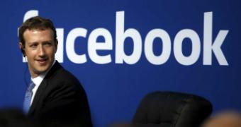 Mark Zuckerberg infront of a Facebook sign