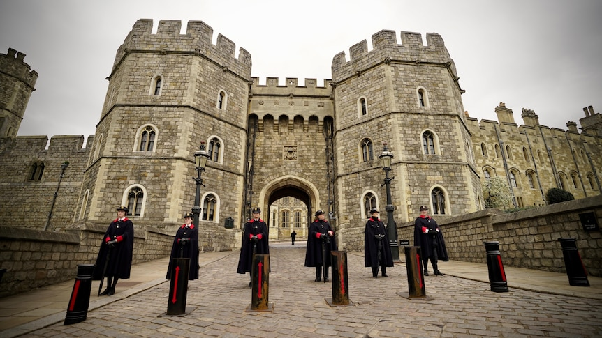 Wardens stand guard outside a Windsor Castle entrance.