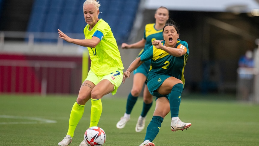 Sam Kerr shouts in pain after kicking Caroline Seger instead of the football during the Australia-Sweden Tokyo Olympics match.