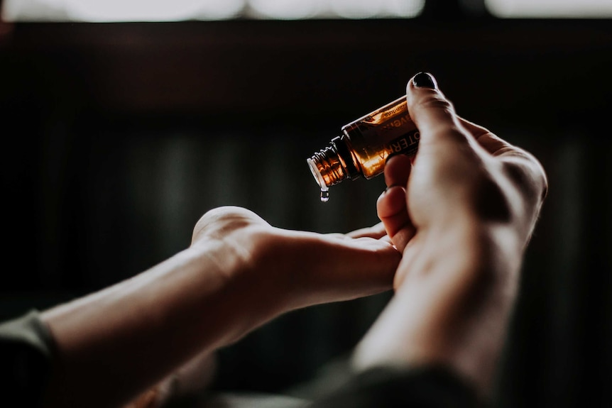Massage oil being poured into someone's hand