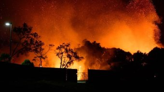 Glowing bushfire and blowing embers out the back of a Peregian Beach property