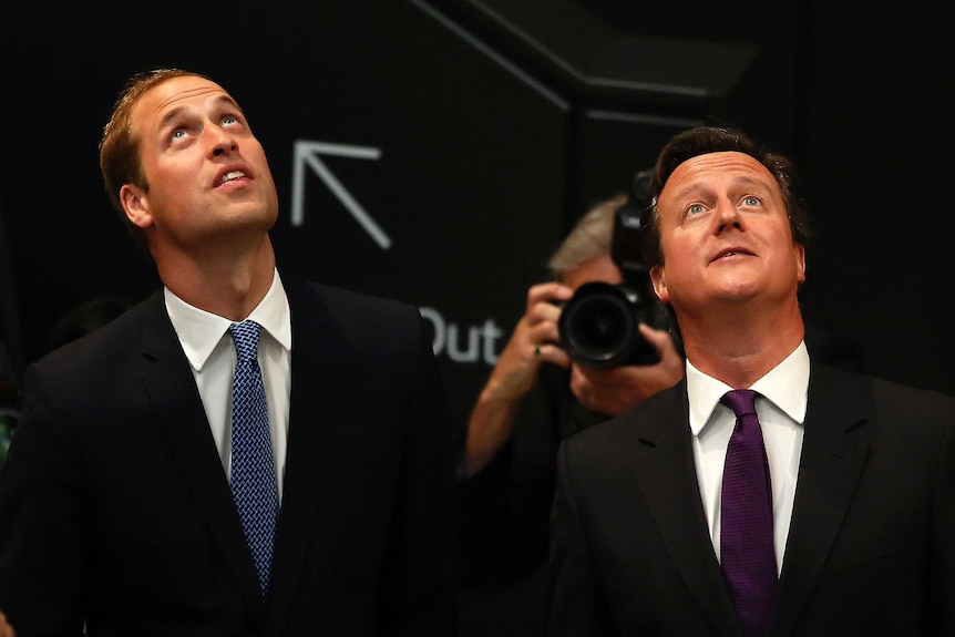 Prince William (L) and David Cameron have been named in FIFA's corruption report into World Cup bids.