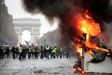"A truck burns during a ""yellow vest"" protest on the Champs-Elysees in Paris."