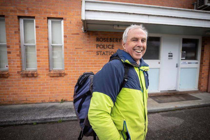 A man outside a police station.