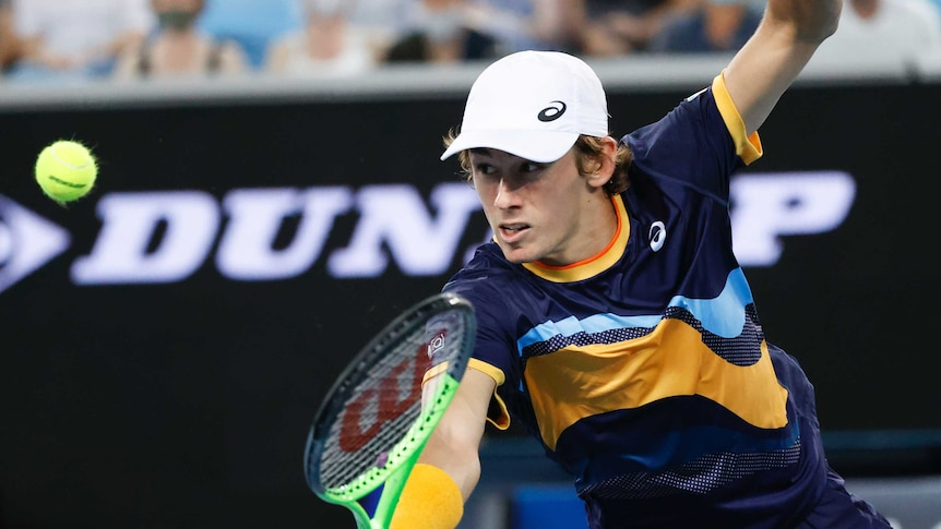 Alex de Minaur plays a one-handed backhand at the Australian Open.