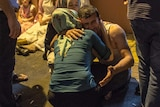 Relatives grieve at hospital following a late night militant attack on a wedding party in Turkey.