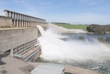 A dam wall has water being released