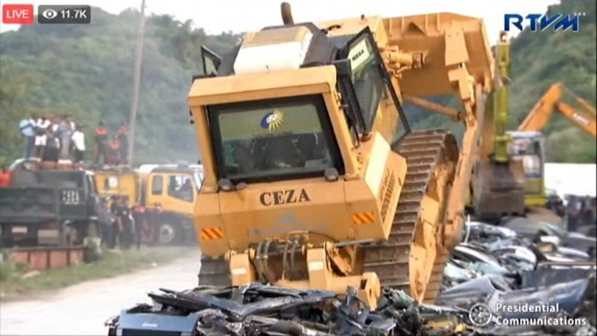 Philippines President oversees the demolition of smuggled luxury cars.
