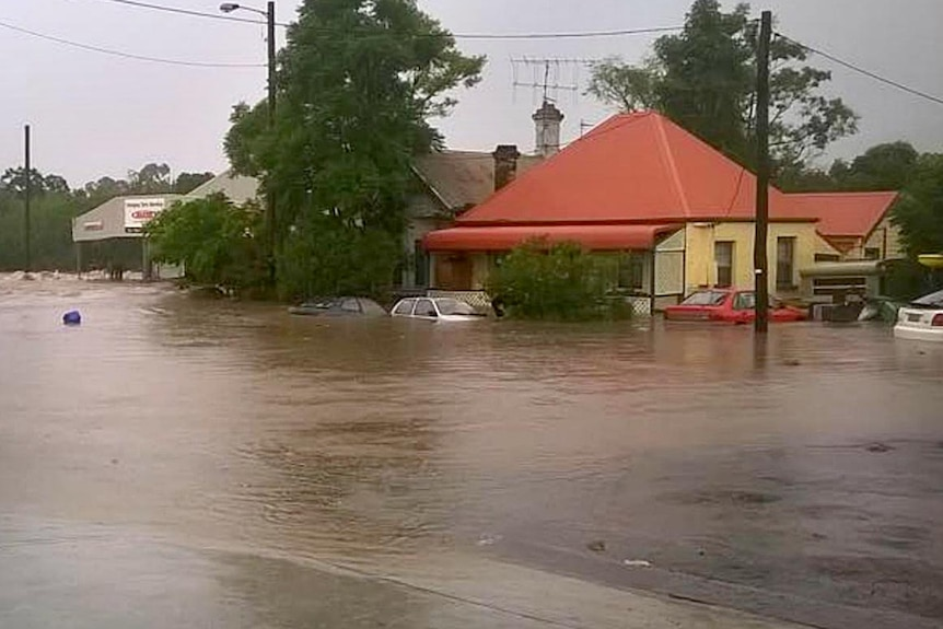 Cars and homes submerged in floodwaters in Dungog, NSW.