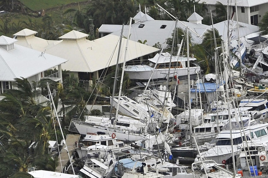 Boats piled on top of each other at the Port Hinchinbrook Marina.