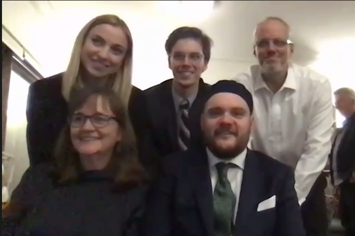 A screenshot of Max and his family on his wedding day.