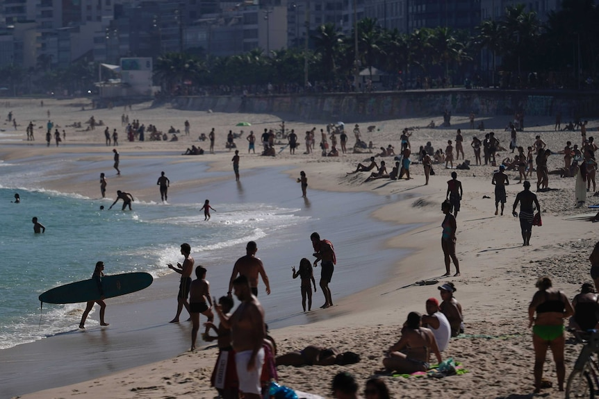 People spend a day in the sun amid the new coronavirus pandemic in Rio.