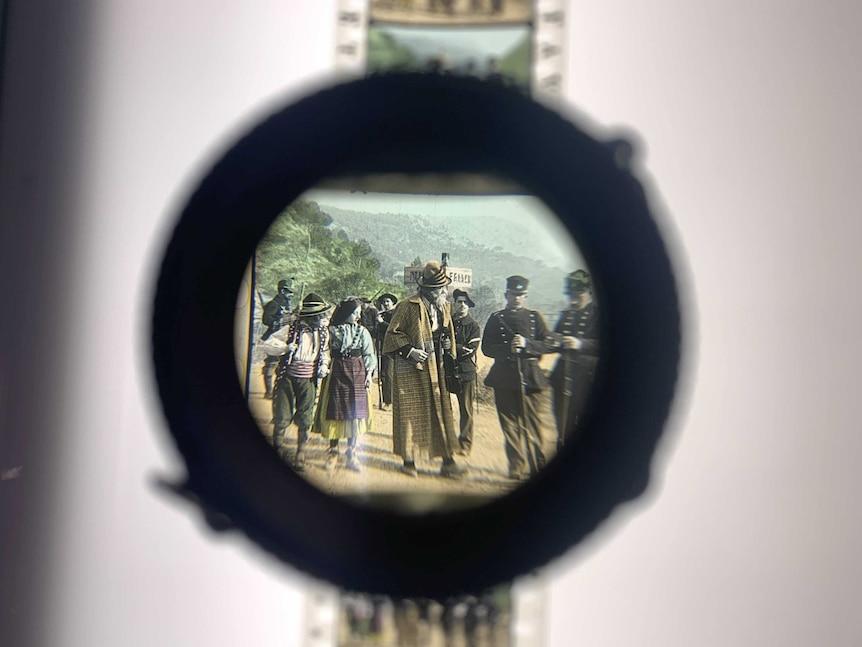 A 1900s photo seen through a magnifying glass.