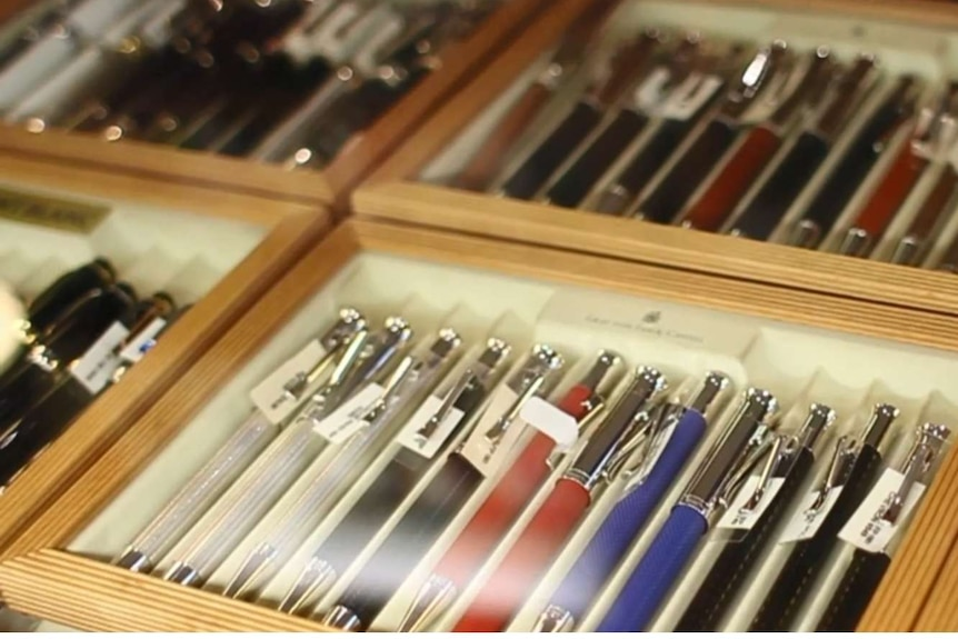 Boxes filled with various pens.