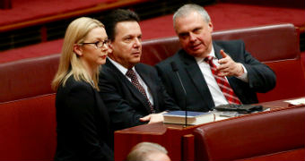 Skye Kakoschke-Moore, Nick Xenophon and Stirling Griff sit together in the senate