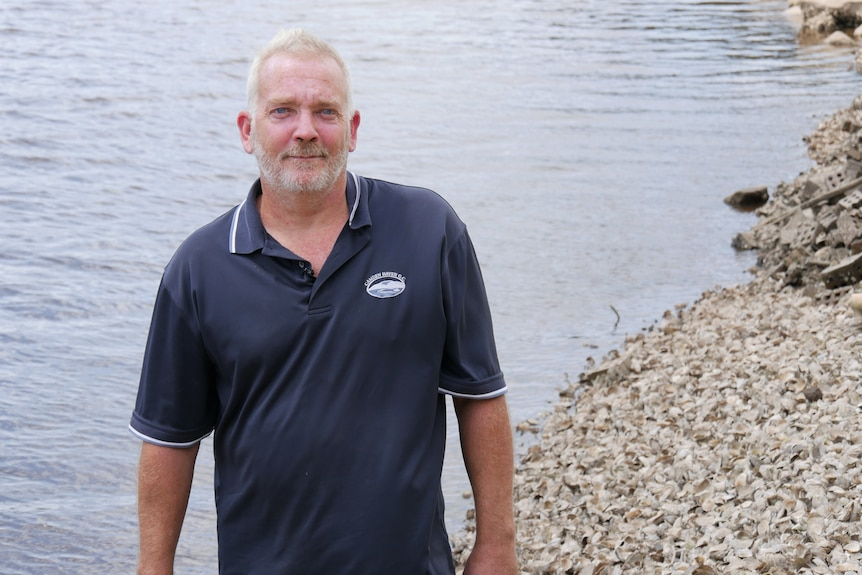 Oyster farmer David Smith in front of the water.