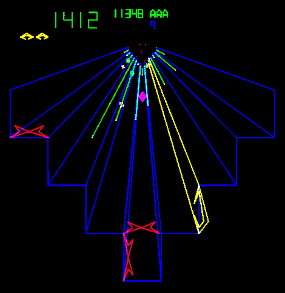 In a scene from a video game neon blue, green, yellow and red lines form a 3D-like abstract shape on black bacground.