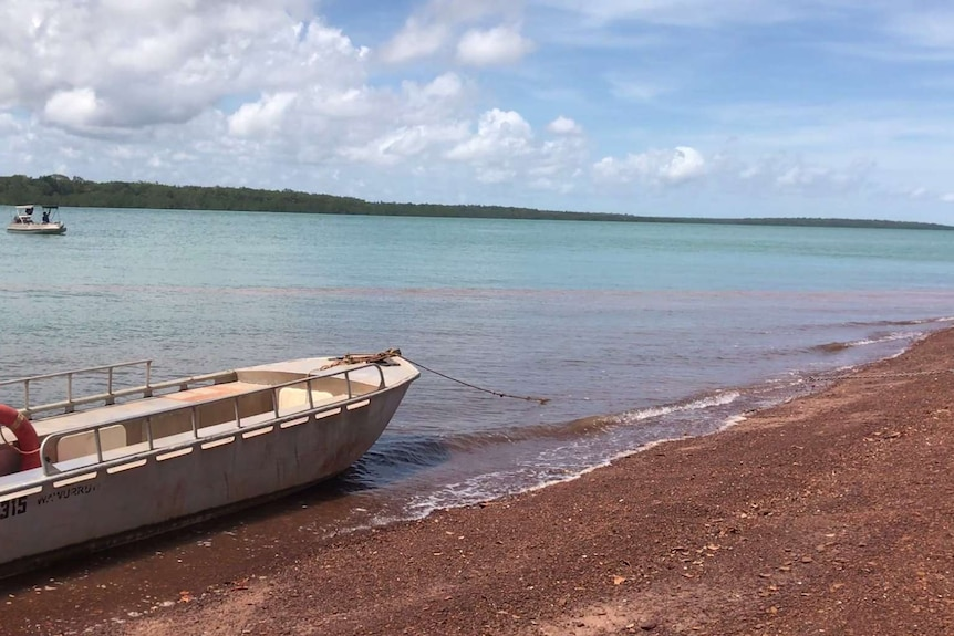 A small boat on the island's shore