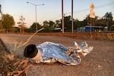 A cask wine bladder lying on a footpath