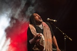 Zaachariaha Fielding of Electric Fields sings on stage at the 2019 NIMAs