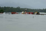 Floodwaters cover the construction site at the Tully River rail bridge
