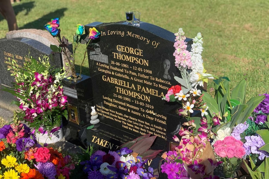 Grave headstone with flowers